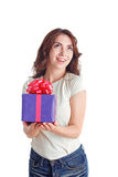 Smiling nice girl holding present Royalty Free Stock Photo