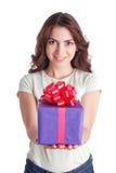 Smiling nice girl holding present Stock Photos