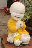 Smiling Novice Statue. In Thai Temple. In Thai culture, novice is a young boy who joining the ordination ceremony Royalty Free Stock Photos
