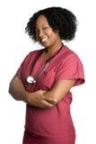 Smiling Nurse. Smiling black nurse wearing scrubs Royalty Free Stock Image