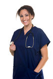 Smiling nurse. Confident Hispanic woman healthcare worker wearing dark blue scrubs holding the end of a stethoscope on white Stock Images