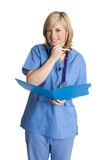 Smiling Nurse. With medical chart stock photo