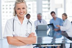 Smiling nurse with arms crossed Stock Photos