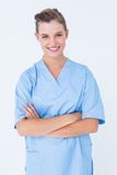 Smiling nurse in blue scrubs posing with arms crossed Stock Photography