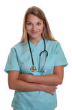 Smiling nurse with crossed arms Royalty Free Stock Photos