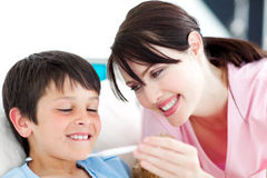 Smiling nurse and his patient with a thermometer Stock Images