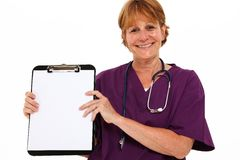 Smiling Nurse Holding Clipboard Stock Images