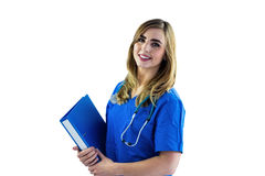 Smiling nurse holding clipboard Royalty Free Stock Images