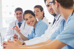 Smiling nurse looking at colleagues Royalty Free Stock Photo