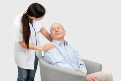 Smiling nurse and old senior man patient. Smiling nurse and old senior men patient. Care for older people concept royalty free stock images