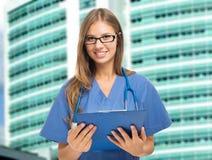 Smiling nurse portrait Stock Images