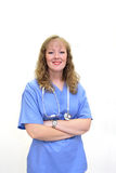 Smiling nurse with stethoscope and scrubs. Torso shot of a Caucasian nurse with long blonde, wavy hair wearing a stethoscope and scrubs. Her arms are crossed stock image