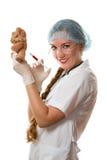 Smiling nurse and syringe Royalty Free Stock Images