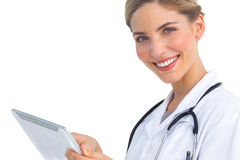 Smiling nurse with tablet pc Royalty Free Stock Photos