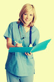 Smiling Nurse Taking Notes royalty free stock photo