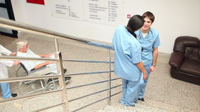 Smiling nurse talking with a colleague Stock Images