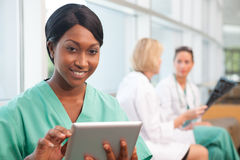 Smiling nurse with two doctors Royalty Free Stock Photography