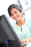 Smiling nurse using headphones Royalty Free Stock Photo