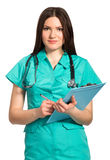 Smiling nurse or young doctor in uniform with clipboard writing Stock Photography