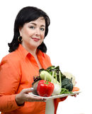 Smiling nutrition coach with a tray of fresh vegetables Royalty Free Stock Photo