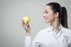 Smiling nutritionist with apple Royalty Free Stock Photo