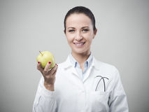 Smiling nutritionist with apple Stock Photos