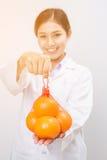 Smiling nutritionist holding orange Royalty Free Stock Image