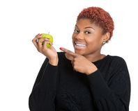 Smiling nutritionist professional holding apple, advising on diet choices Stock Photo
