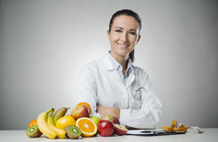 Smiling nutritionist at work Royalty Free Stock Photo