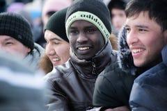 Smiling observers at the Maslenitsa festival stock images