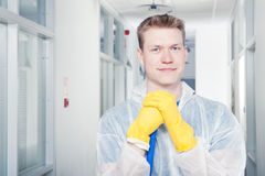 Smiling office cleaner Stock Image