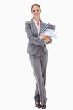 Smiling office employee with pile of paperwork Stock Photography