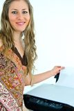 Smiling office girl with a printer. And paper stock image