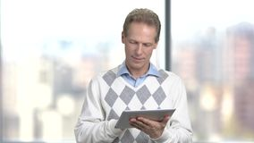 Smiling office manager with pc tablet. stock video footage
