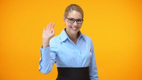 Smiling office manager waving hand, friendly company worker, female colleague. Stock footage stock footage