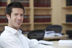 Smiling Office Worker In Office Royalty Free Stock Photos