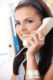 Smiling office worker on phone Stock Images