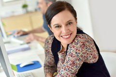 Smiling office-worker royalty free stock images