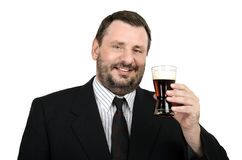 Smiling officeman holds glass of ale. Smiling bearded officeman holds glass of ale on a white background Stock Photography