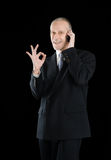 Smiling Okay Businessman on Phone Royalty Free Stock Images