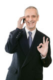 Smiling Okay Businessman on Phone Stock Images