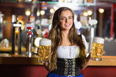 Smiling oktoberfest barmaid with beer Stock Photo