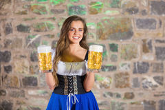 Smiling oktoberfest barmaid with beer Stock Photography