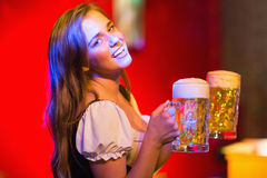 Smiling oktoberfest barmaid with beer Stock Image