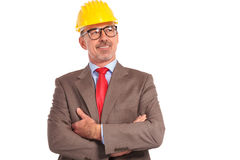 Smiling old construction engineer looking up to his side Royalty Free Stock Photo