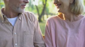 Smiling old couple embracing, posing for camera, well-being happiness, care. Stock footage stock video