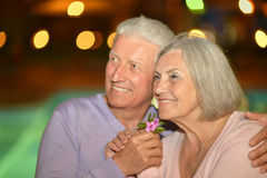Smiling old couple with flowers Stock Image