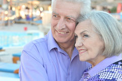 Smiling old couple. Portrait of an amusing smiling old couple on vacation royalty free stock images