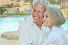 Smiling old couple. Portrait of a happy amusing smiling old couple on vacation Royalty Free Stock Photos