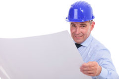 Smiling old engineer reading project Royalty Free Stock Images
